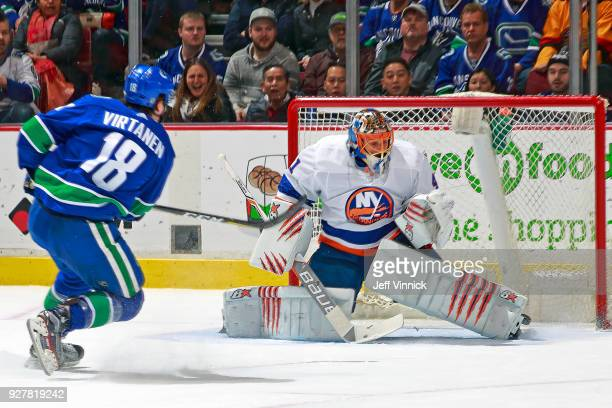 Jake Virtanen of the Vancouver Canucks scores against Jaroslav Halak of the New York Islanders during their NHL game at Rogers Arena March 5 2018 in...