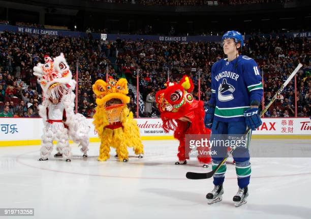 Jake Virtanen of the Vancouver Canucks skates by Chinese dragons during their NHL game before their NHL game against the Boston Bruins at Rogers...