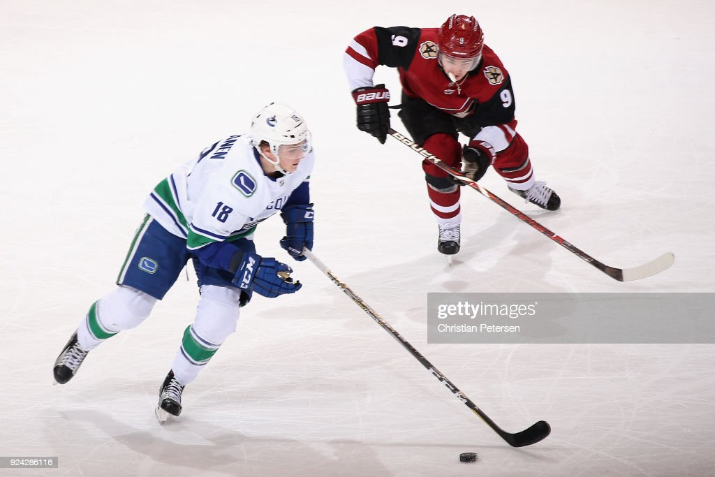 Jake Virtanen #18 of the Vancouver Canucks skates the puck past Clayton Keller #9 of the Arizona Coyotes during the second period of the NHL game at Gila River Arena on February 25, 2018 in Glendale, Arizona.