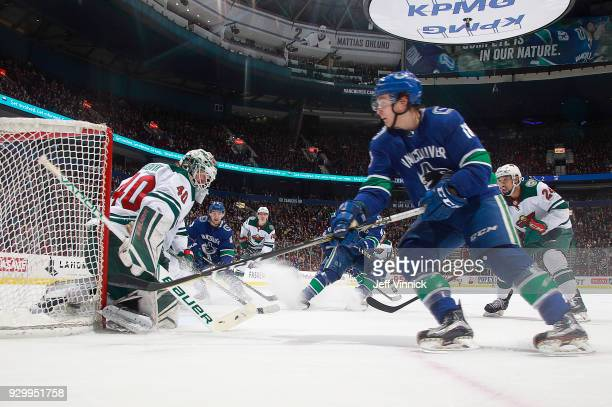 Jake Virtanen of the Vancouver Canucks takes a shot against Devan Dubnyk of the Minnesota Wild during their NHL game at Rogers Arena March 9 2018 in...