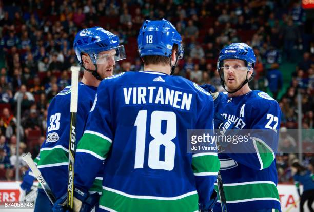 Jake Virtanen of the Vancouver Canucks talks with Daniel Sedin and Henrik Sedin during their NHL game against the Dallas Stars at Rogers Arena...