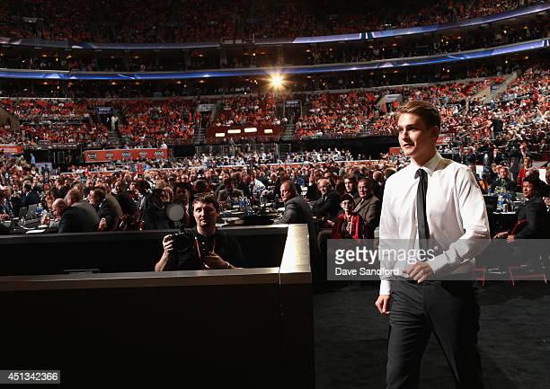 Jake Virtanen walks to the stage after being selected sixth overall by the Vancouver Canucks during the 2014 NHL Entry Draft at Wells Fargo Center on...