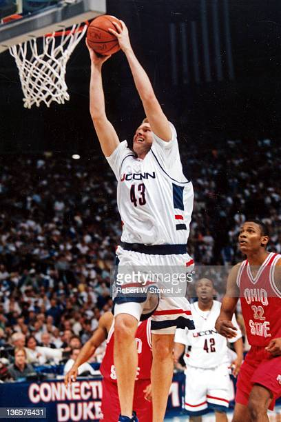 Jake Voskhul of the University of Connecticut takes it to the hoop and jams it home vs Ohio State in the NCAA semifinals St Petersburg FL 1999