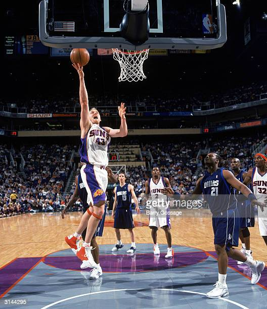 Jake Voskuhl of the Phoenix Suns shoots a layup during the game against the Dallas Mavericks at America West Arena on March 13 2004 in Phoenix...