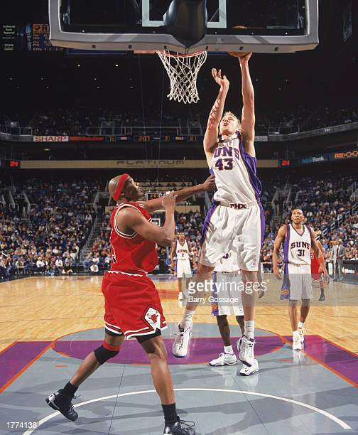 Jake Voskuhl of the Phoenix Suns takes the layup against Corie Blount of the Chicago Bulls during the game at America West Arena on February 3 2003...