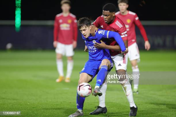 Jake Wakeeling of Leicester City in action with Teden Mengi of Manchester United during the Premier League 2 match between Leicester City and...