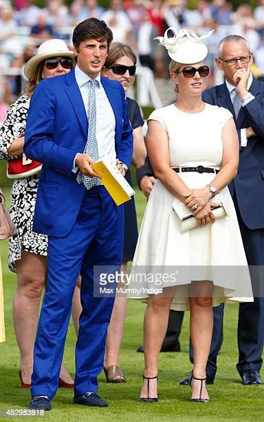 Jake Warren and Zara Phillips watch Queen Elizabeth II's horse Estimate run in the Artemis Goodwood Cup on Ladies Day of Glorious Goodwood at...
