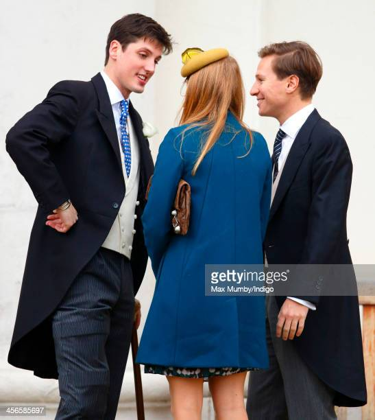 Jake Warren greets Princess Beatrice of York and Dave Clark as they arrive to attend his and Zoe Stewart's wedding in the Wren Chapel at the Royal...