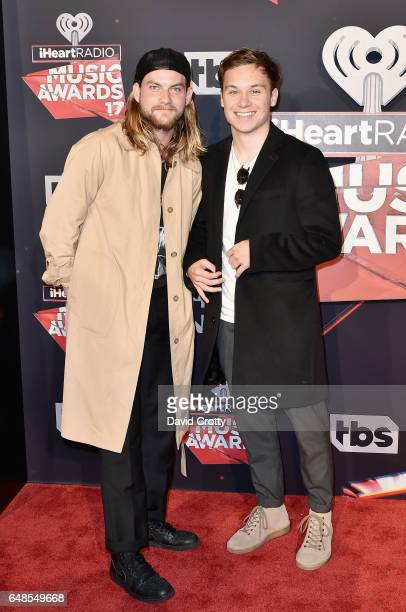 Jake Weary and Finn Cole attends the 2017 iHeartRadio Music Awards Arrivals at The Forum on March 5 2017 in Inglewood California