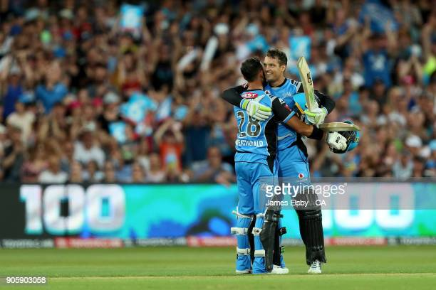 Jake Weatherald helps Alex Carey of the Adelaide Strikers celebrate his 100 during the Big Bash League match between the Adelaide Strikers and the...