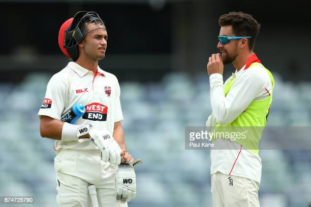 Jake Weatherald of South Australia talks with Alex Ross at a break in play during day four of the Sheffield Shield match between Western Australia...