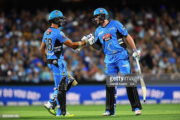 Jake Weatherald of the Adelaide Strikers congratulates Ben Dunk of the Adelaide Strikers on reaching his half century during the Big Bash League...
