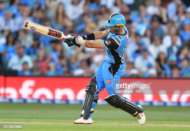 Jake Weatherald of the Adelaide Strikers drives for six during the Adelaide Strikers v Melbourne Renegades Big Bash League Match at Adelaide Oval on...