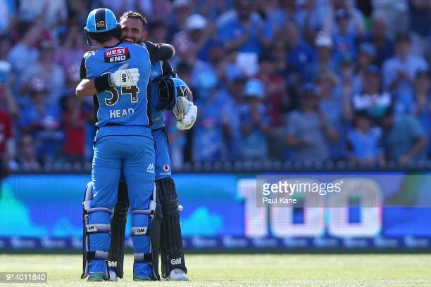 Jake Weatherald of the Strikers celebrates his century with Travis Head during the Big Bash League Final match between the Adelaide Strikers and the...
