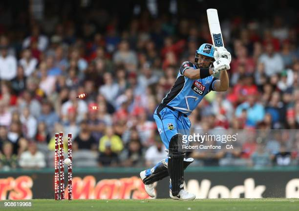 Jake Weatherald of the Strikers is bowled by Chris Tremain of the Renegades during the Big Bash League match between the Melbourne Renegades and the...
