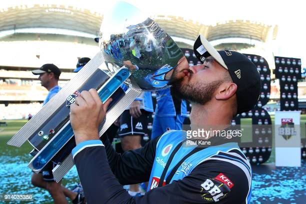 Jake Weatherald of the Strikers kisses th etrophy after winning the Big Bash League Final match between the Adelaide Strikers and the Hobart...