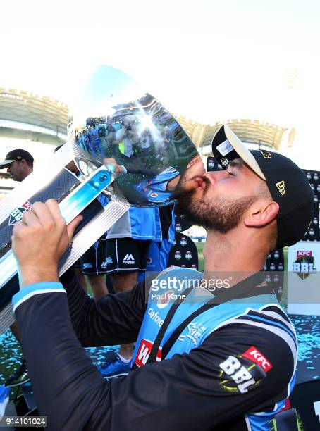 Jake Weatherald of the Strikers kisses the trophy after winning the Big Bash League Final match between the Adelaide Strikers and the Hobart...