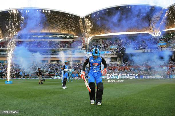 Jake Weathered and Alex Carey of the Adelaide Strikers walk out to bat during the Big Bash League match between the Adelaide Strikers and the...