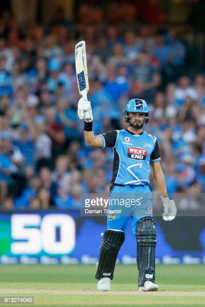 Jake Weathered of the Adelaide Strikers raises his bat after scoring 50 runs during the Big Bash League match between the Adelaide Strikers and the...