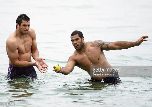 Jake Webster of the Storm catches a tennis ball ahead of a teammate during a Melbourne Storm recovery session at St Kilda Beach on September 6 2006...