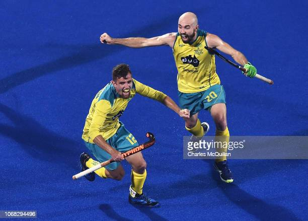 Jake Whetton of Australia celebrates scoring the first goal with Matthew Swann during the FIH Men's Hockey World Cup Group B match between England...