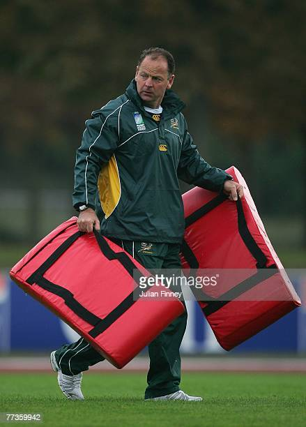 Jake White coach of South Africa carries training pads during the South Africa training session at the Stade Alain Mimoun on October 17 2007 in Noisy...