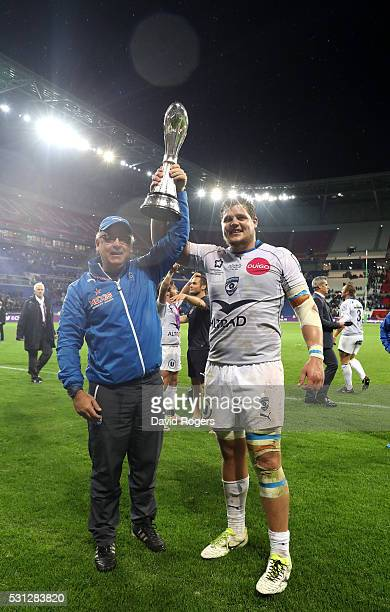 Jake White the head coach of Montpellier and Paul Willemse of Montpellier celebtrate with the trophy following their team's 2619 victory during the...