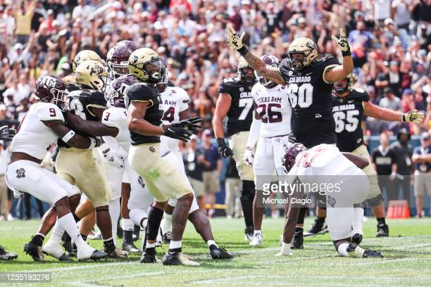 Jake Wiley of the Colorado Buffaloes celebrates a touchdown by Jarek Broussard against the Texas A&M Aggies during the first quarter at Empower Field...