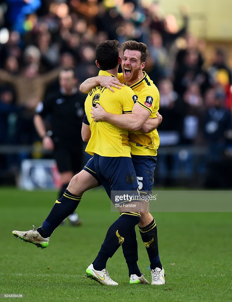 Jake Wright and Johnny Mullins of Oxford United celebrate their team's 3-2 victory as the final whistle blows during The Emirates FA Cup third round match between Oxford United and Swansea City at the Kassam Stadium on January 10, 2016 in Oxford, England.