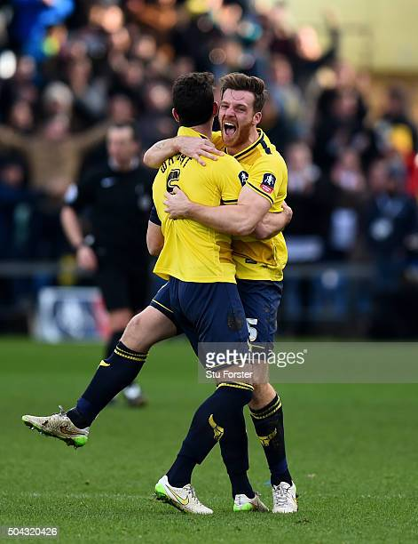 Jake Wright and Johnny Mullins of Oxford United celebrate their team's 32 victory as the final whistle blows during The Emirates FA Cup third round...