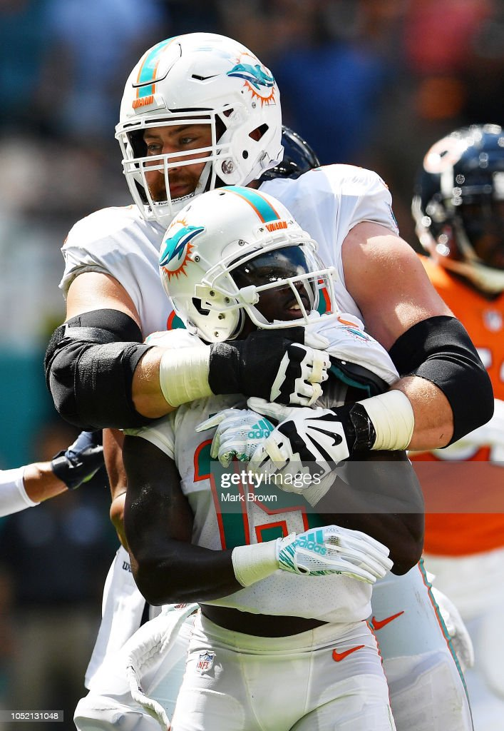 outlet store 23247 0d50a Jakeem Grant and Jesse Davis of the Miami Dolphins react in ...