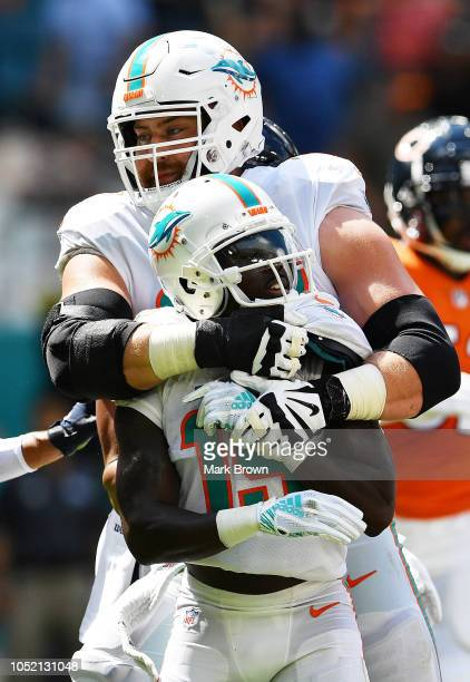 Jakeem Grant and Jesse Davis of the Miami Dolphins react in the first quarter against the Chicago Bears in the game at Hard Rock Stadium on October...