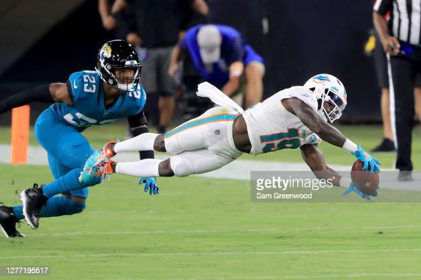 Jakeem Grant of the Miami Dolphins attempts a reception against C.J. Henderson of the Jacksonville Jaguars during the game at TIAA Bank Field on...