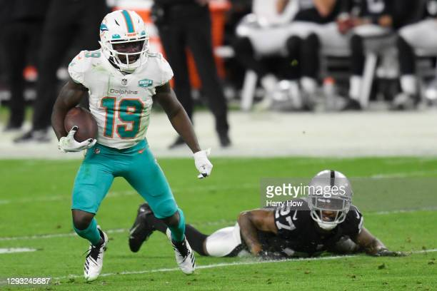 Jakeem Grant of the Miami Dolphins avoids a tackle by Trayvon Mullen of the Las Vegas Raiders \d3at Allegiant Stadium on December 26, 2020 in Las...