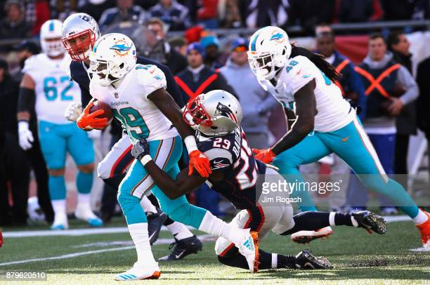 Jakeem Grant of the Miami Dolphins carries the ball as he is tackled by Johnson Bademosi of the New England Patriots during the first quarter of a...