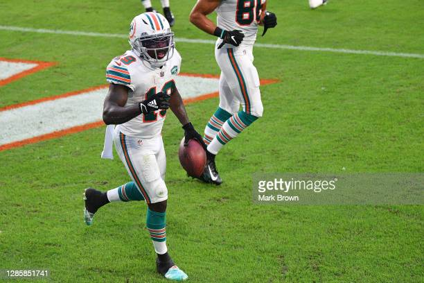 Jakeem Grant of the Miami Dolphins celebrates a three-yard touchdown reception against the Los Angeles Chargers during the first half at Hard Rock...
