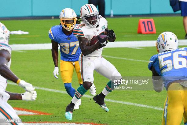 Jakeem Grant of the Miami Dolphins completes a three-yard touchdown reception against the Los Angeles Chargers during the first half at Hard Rock...