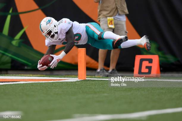 Jakeem Grant of the Miami Dolphins dives for a touchdown after returning a punt 70 yards during the second quarter of the game against the Cincinnati...