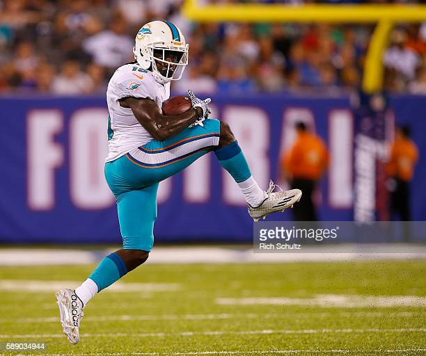 Jakeem Grant of the Miami Dolphins makes a catch for a first down during the second half against the New York Giants in an NFL preseason game at...