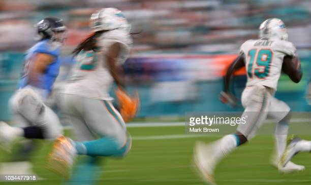 Jakeem Grant of the Miami Dolphins runs a kickoff back for a touchdown during the game against the Tennessee Titans at Hard Rock Stadium on September...