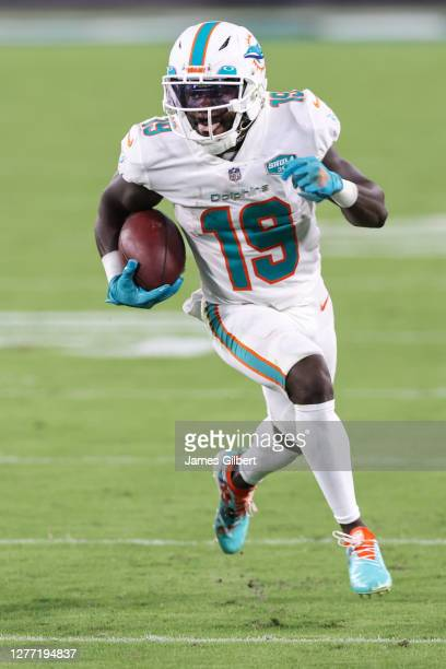 Jakeem Grant of the Miami Dolphins runs for yardage during the first quarter of a game against the Jacksonville Jaguars at TIAA Bank Field on...