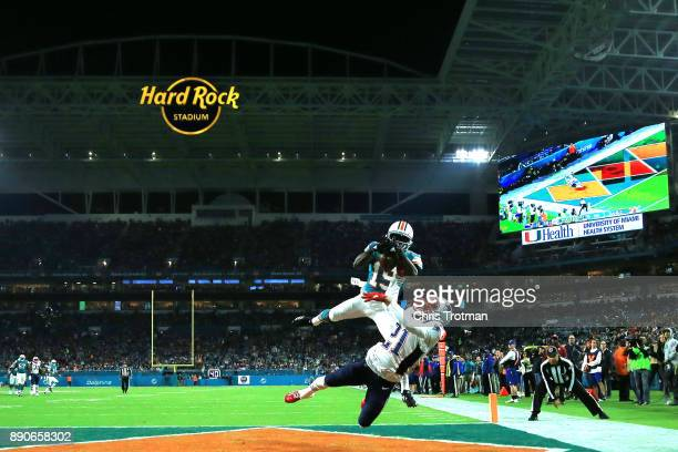 Jakeem Grant of the Miami Dolphins scores a touchdown against the defense of Malcolm Butler of the New England Patriots in the third quarter at Hard...