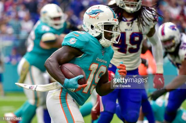Jakeem Grant of the Miami Dolphins scores on a 7-yard touchdown run in the fourth quarter against the Buffalo Bills at Hard Rock Stadium on November...