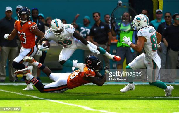 Jakeem Grant of the Miami Dolphins tries to avoid the tackle of Adrian Amos of the Chicago Bears in the first quarter of the game at Hard Rock...