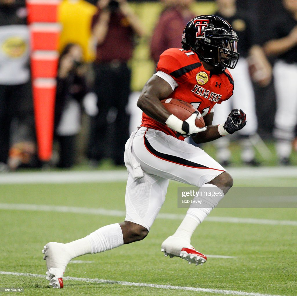 Jakeem Grant #11 of the Texas Tech Red Raiders returns a kickoff for 99 yards against the Minnesota Golden Gophers during the Meineke Car Care of Texas Bowl at Reliant Stadium on December 28, 2012 in Houston, Texas. Texas Tech defeated Minnesota 34-31.