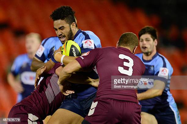 Jakiel Mariner of NSW is tackled during the U20's State of Origin match between the New South Wales Blues and the Queensland Maroons at Sportingbet...