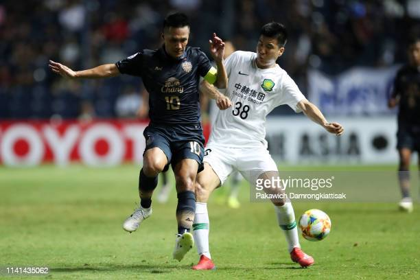 Jakkaphan Kaewprom of Buriram United and Wang Gang of Beijing Guoan compete for the ball during the AFC Champions League Group G match between...