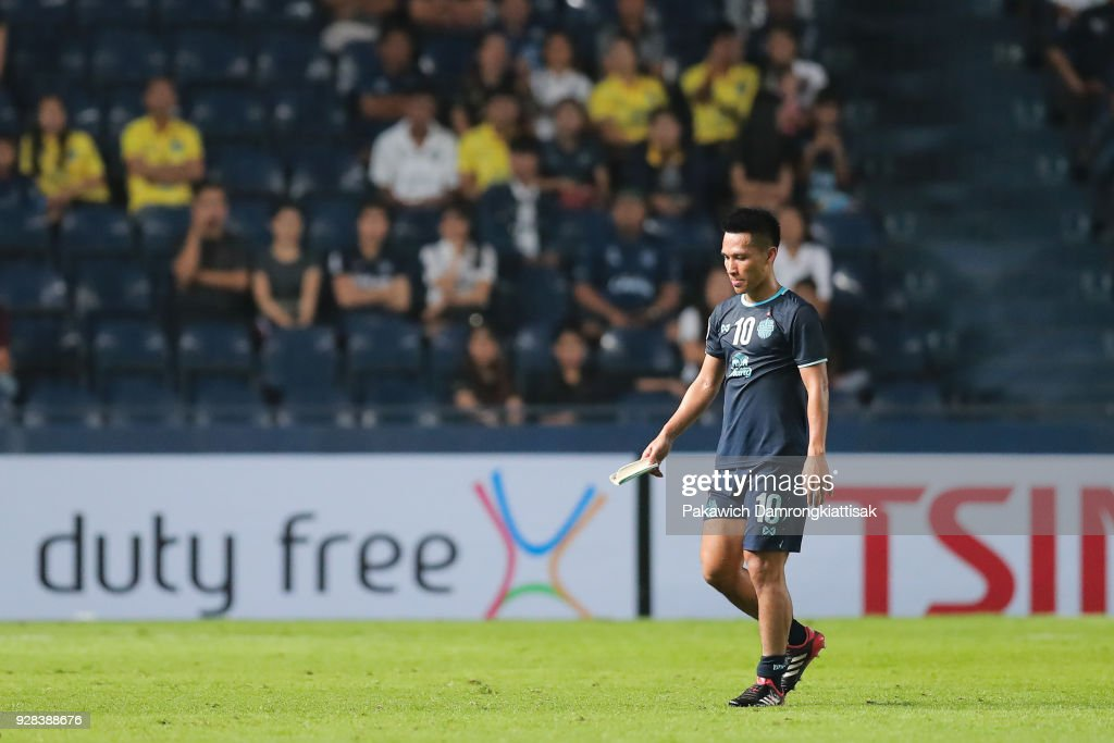 Jakkaphan Kaewprom #10 of Buriram United FC walks out of the field after received red card during the AFC Champions League Group G match between Buriram United Football Club and Cerezo Osaka at Thunder Castle on March 6, 2018 in Buriram, Thailand.