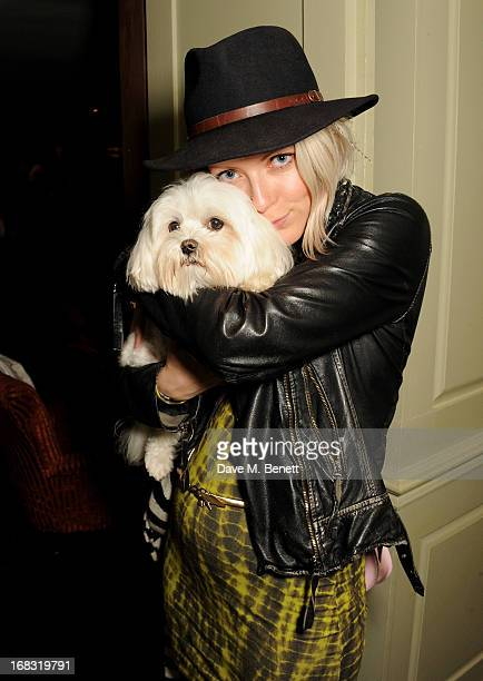 "Jakki Healy holds dog Frankie Benett at a book launch party for ""Pearl Lowe's Vintage Craft: 50 Craft Projects and Home Styling Advice"" by Pearl Lowe..."