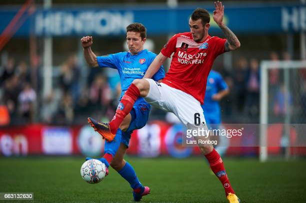 Jakob Ahlmann of AaB Aalborg and Jens Martin Gammelby of Silkeborg IF compete for the ball during the Danish Alka Superliga match between Silkeborg...